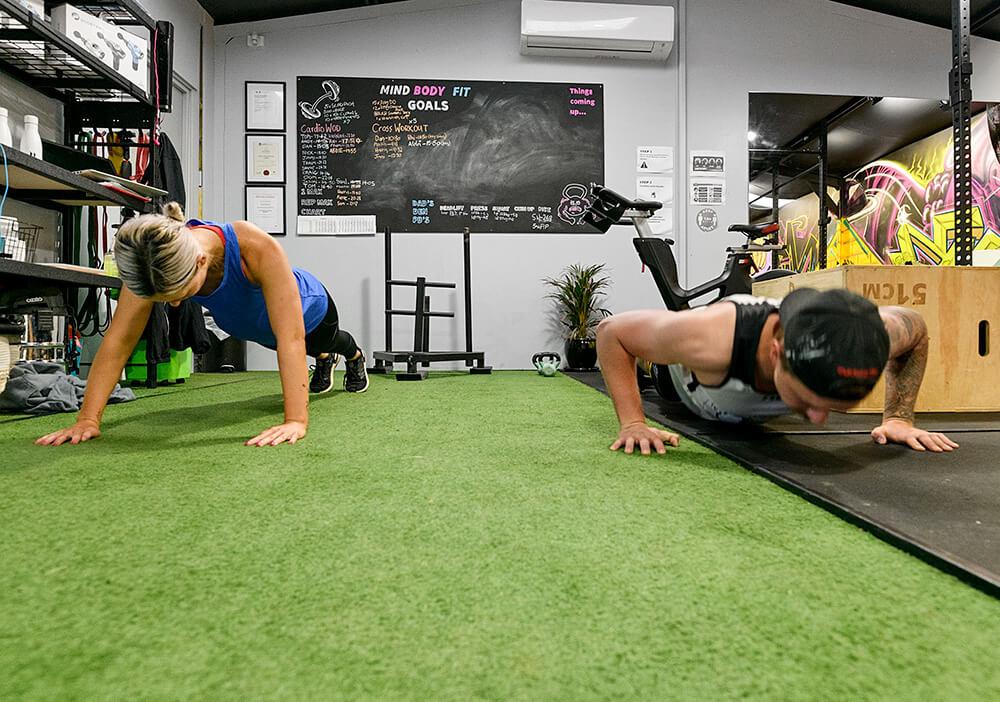 Woman and man doing push ups, inside TriActive gym Euroa