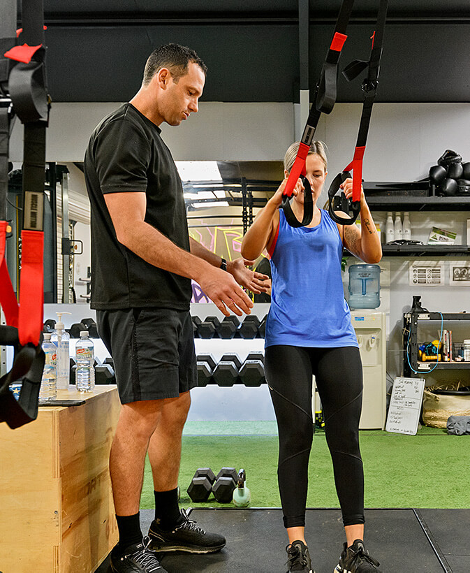 Woman having a personal training session at TriActive