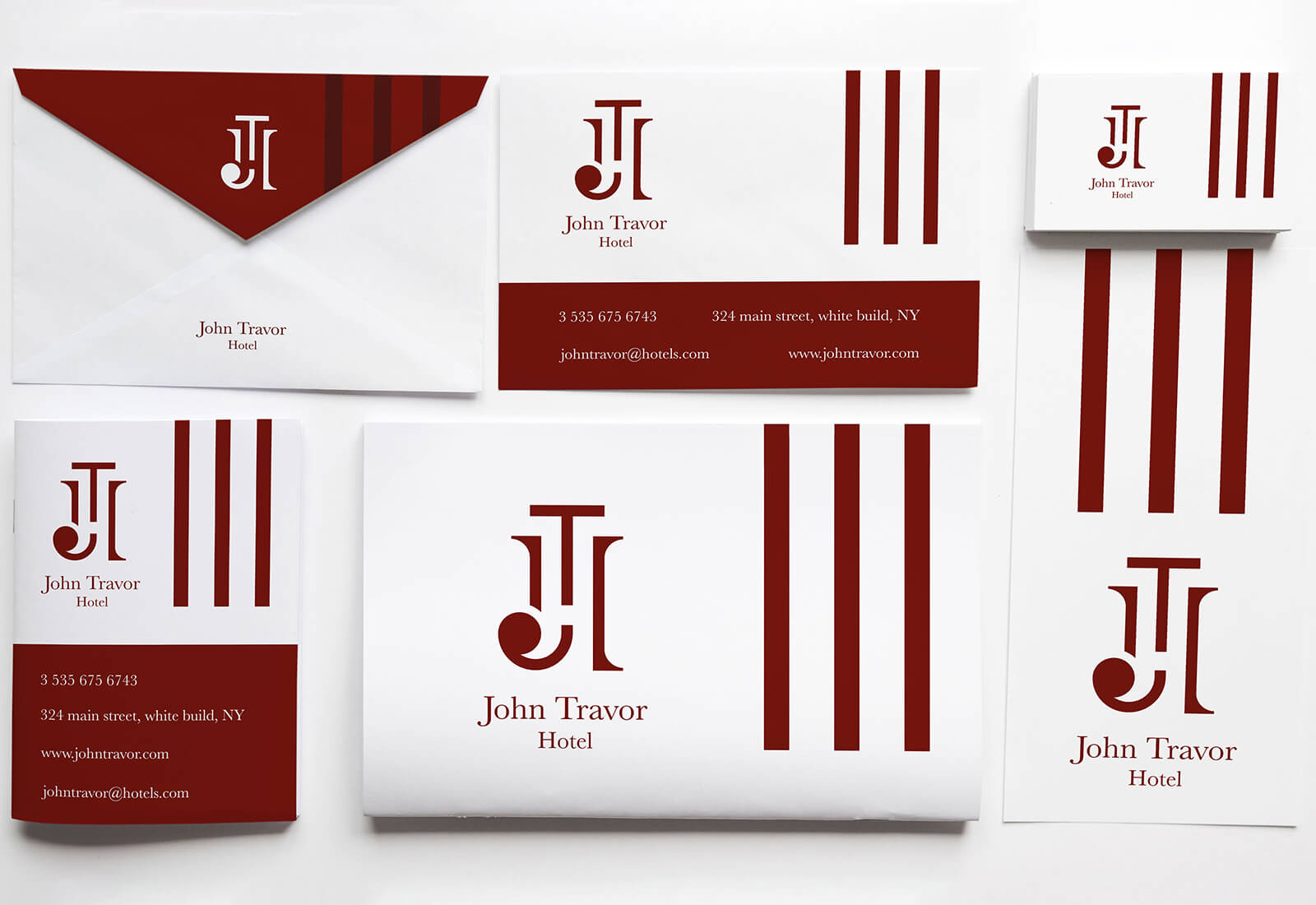 logo e brand identity design di john travor hotel su buste, carte intestate e biglietti da visita bianchi su sfondo grigio chiaro