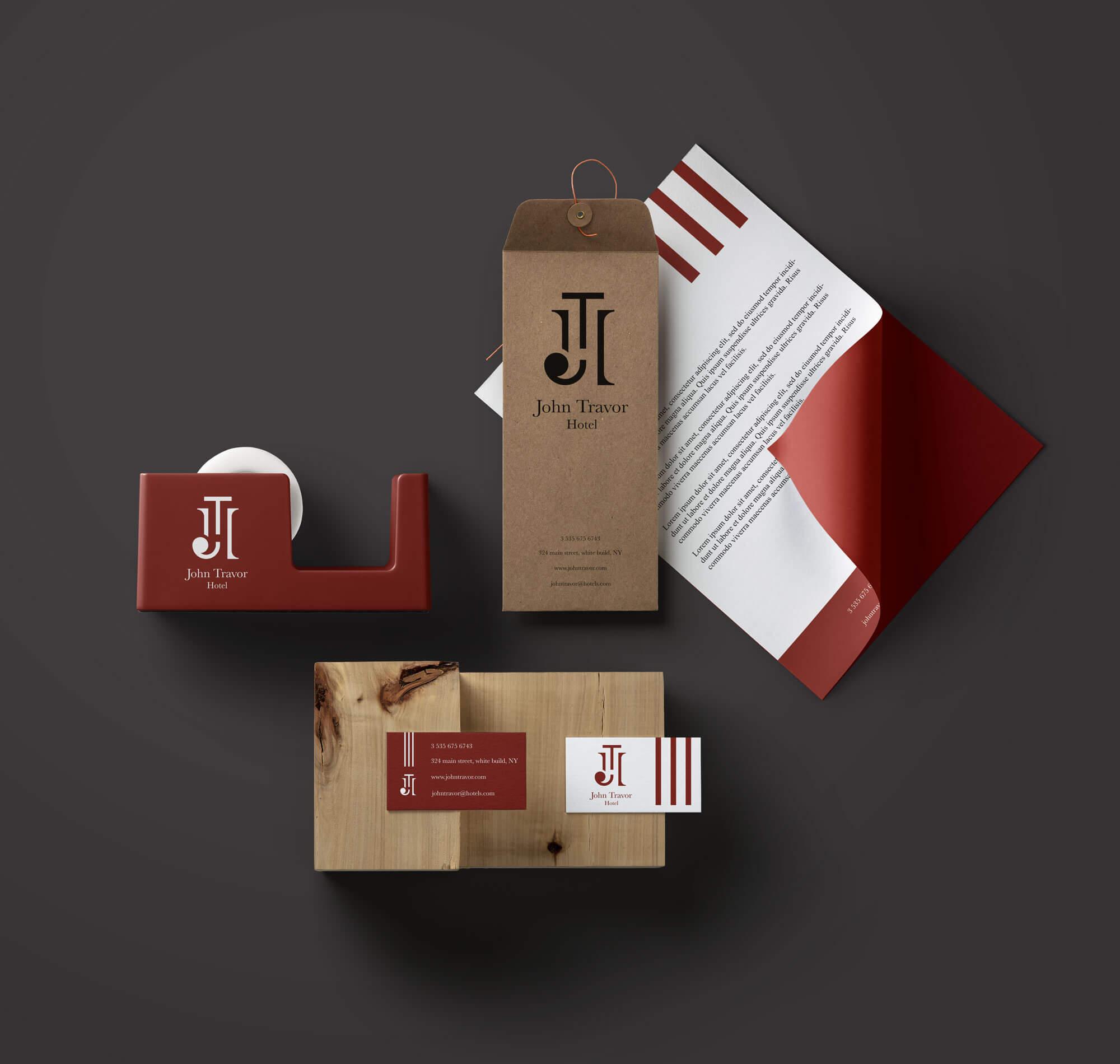 logo e brand identity design di john travor hotel su carta intestata e biglietti da visita bianchi su sfondo grigio scuro