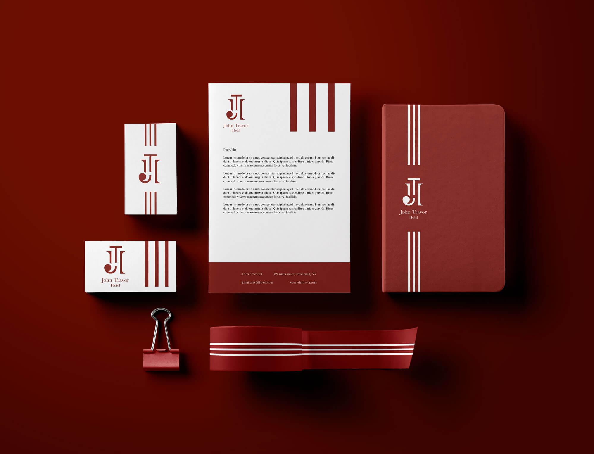logo e brand identity design di john travor hotel su barta intestata e biglietti da visita di colore bianco e su agenda e nastro di colore rosso. Gli oggetti sono su sfondo bordeaux