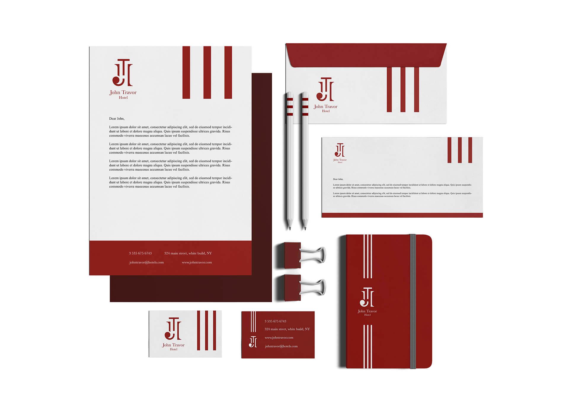logo e brand identity design di john travor hotel su carta intestata e biglietti da visita bianchi e su agenda rossa. tutti gli oggetti sono su sfondo bianco