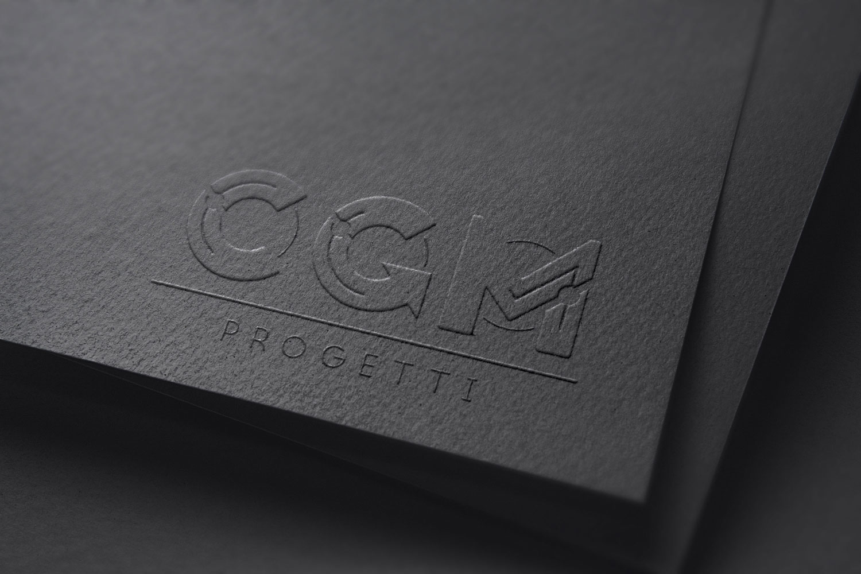 cartoncino nero con inciso in logo di CGM Progetti in nero