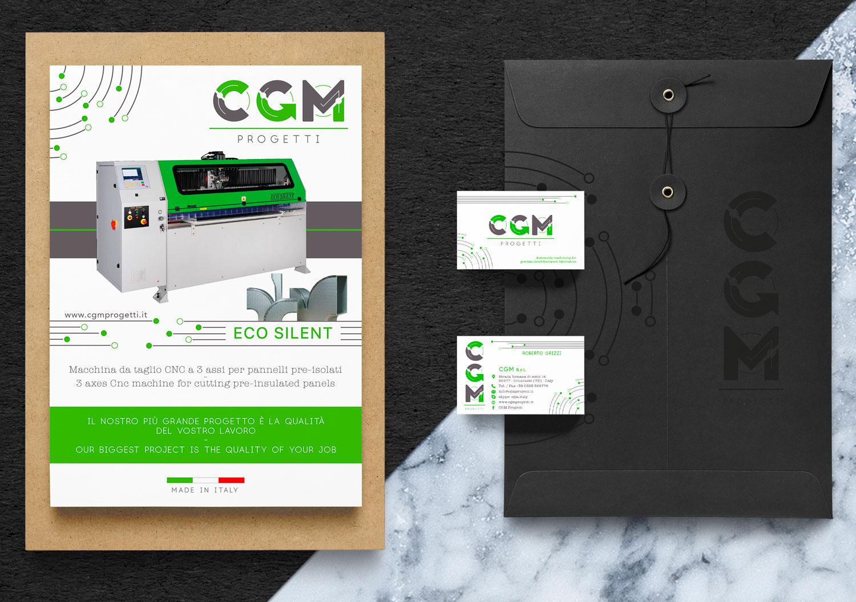 sulla sinistra un catalogo di CGM Progetti e sulla destra una cartelletta nera con due biglietti da visita. Tutto appoggiato su una superficie di marmo
