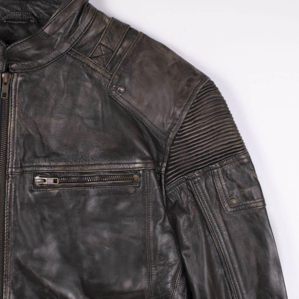 Shoulder and Chest Detail of Black Distressed Leather Racer Jacket