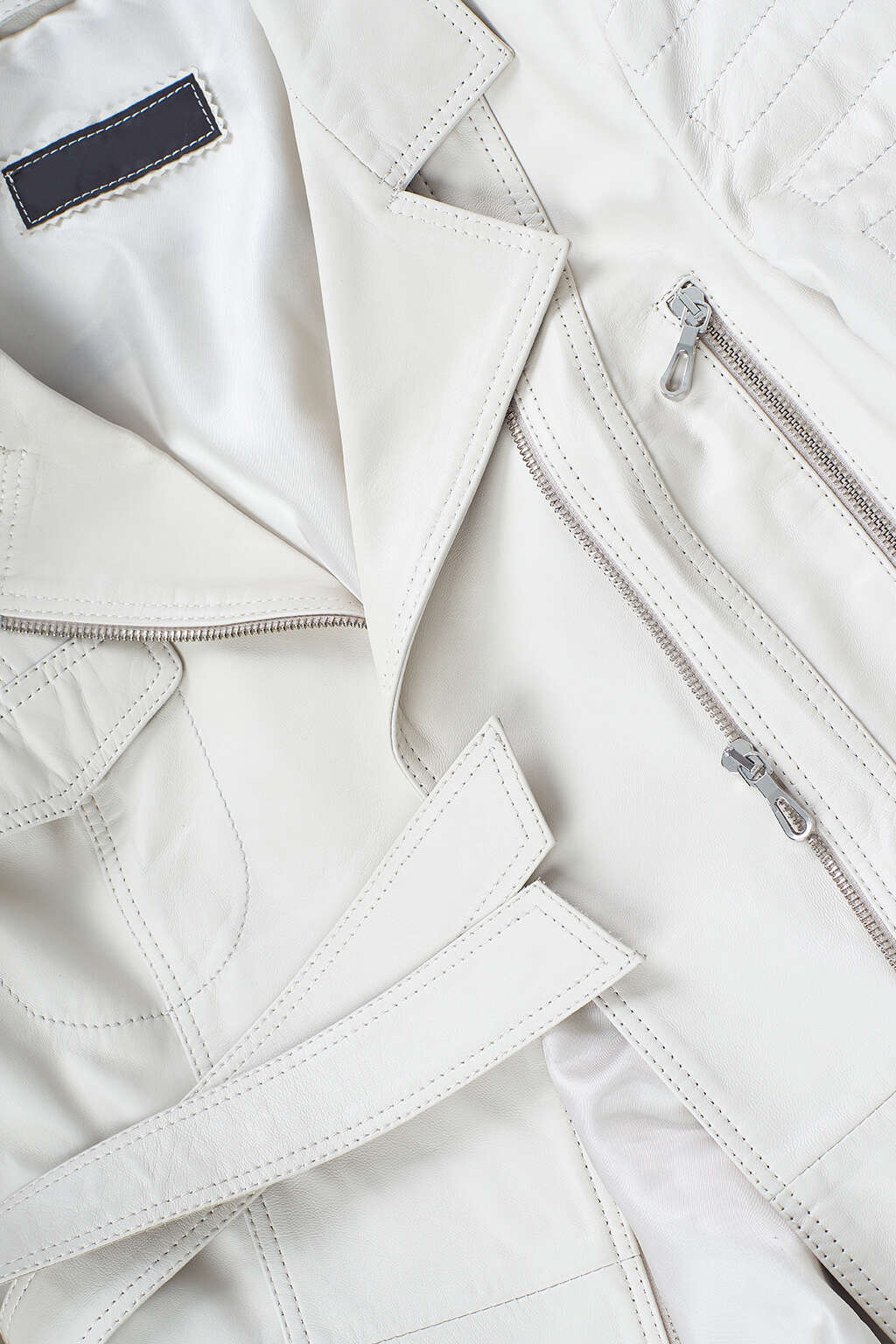 Belt and Collar Detail of Pearl White Belted Leather Jacket