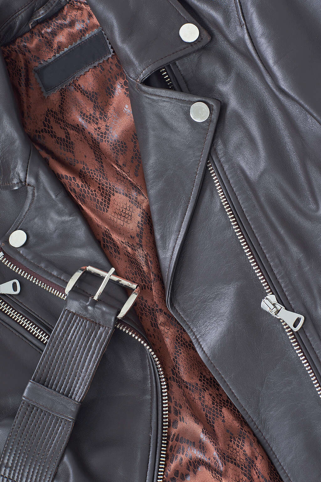 Buckle and Inner Lining Detail of Matte Black Leather Biker Jacket with Buckle