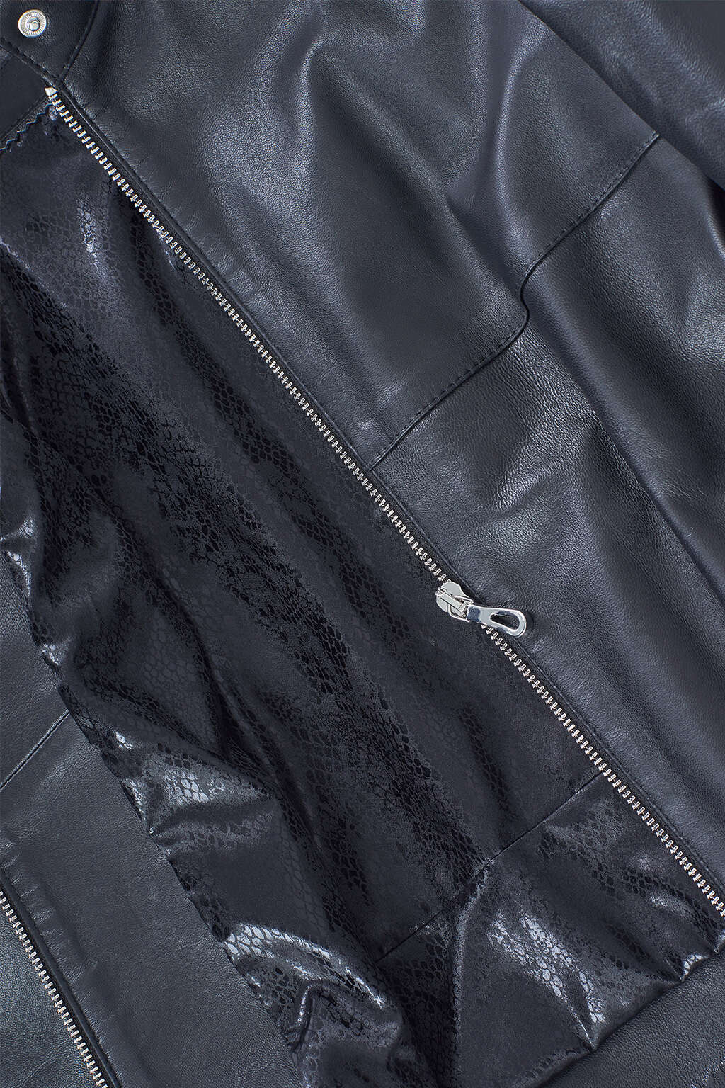 Zipper and Inner Lining Detail of Jet Black Leather Moto Jacket