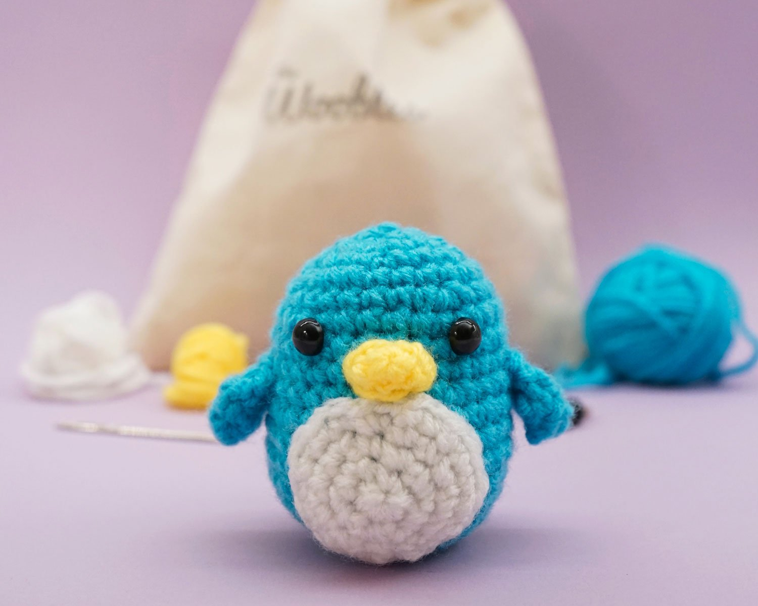 A crocheted penguin from The Woobles.
