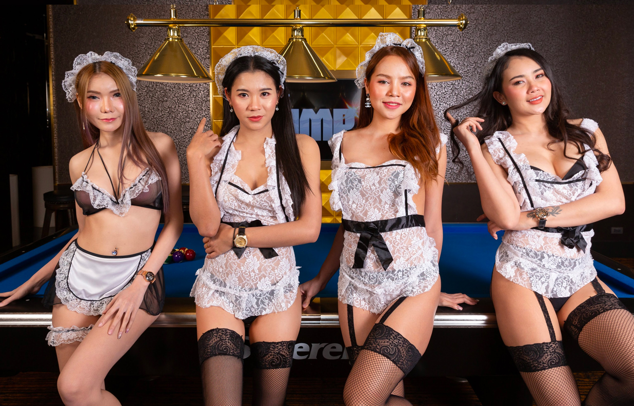 beautiful Thai girls standing by the pool table in a KTV room of the PIMP Bangkok