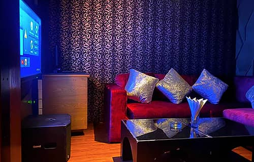 photo of a small KTV room at The PIMP gentlemen club in Bangkok
