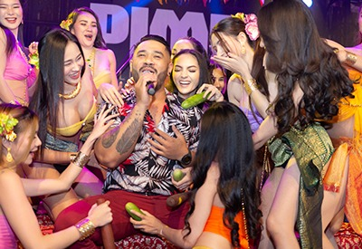 singer surrounded by sexy Thai girls on the stage of The PIMP Bangkok