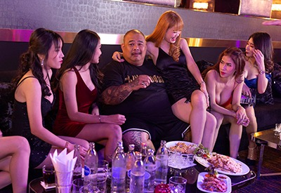 Thai guy partying with gorgeous Thai girl in a private VIP room at The PIMP Bangkok