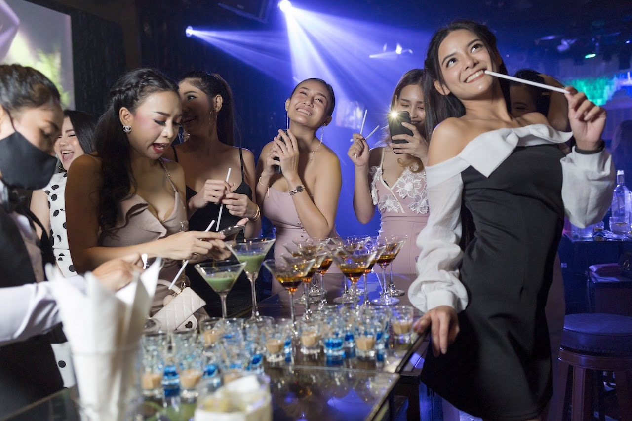 Thai girls partying at a VIP table in a gentlemen club