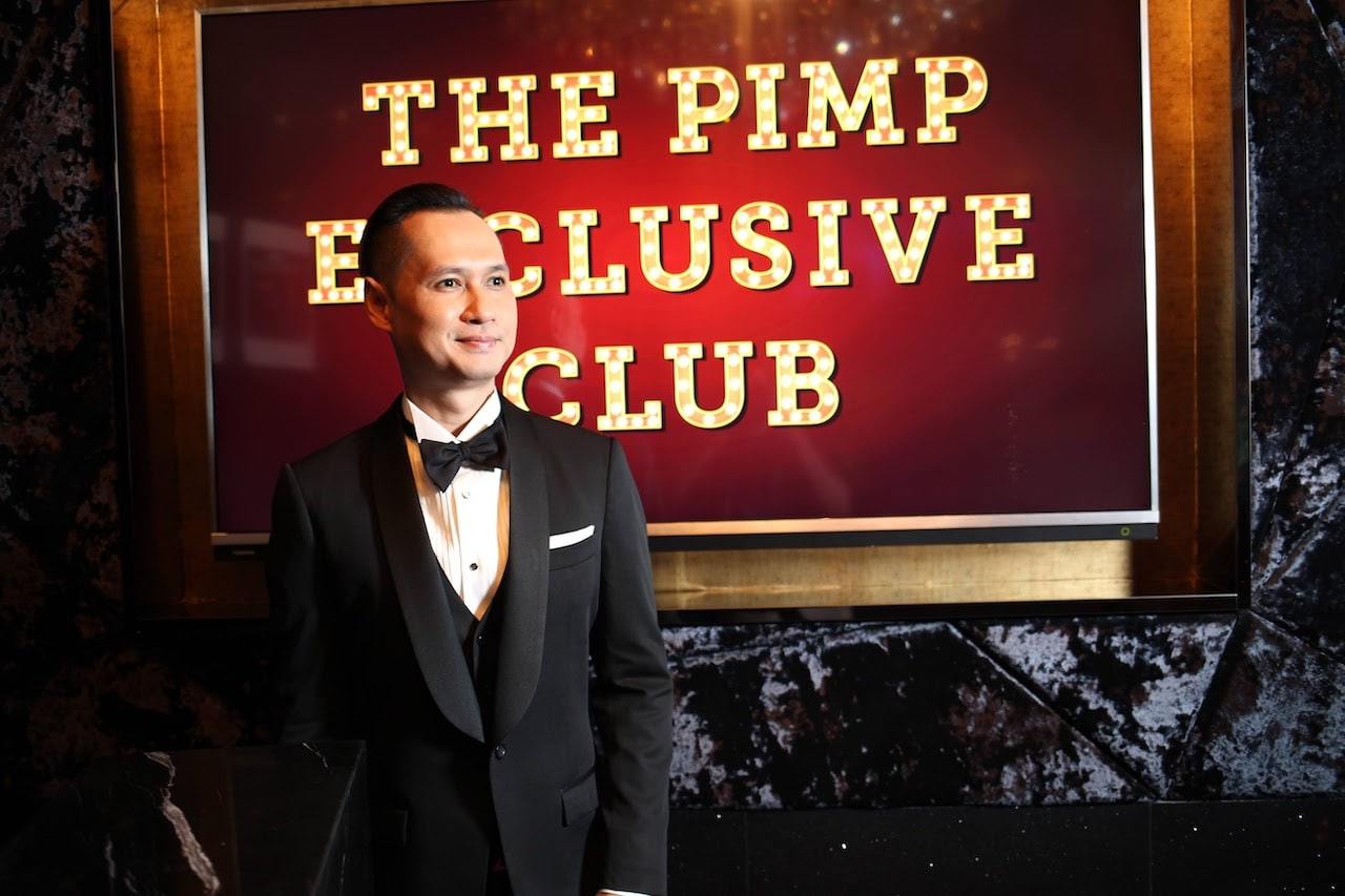The PIMP Exclusive club sign and host
