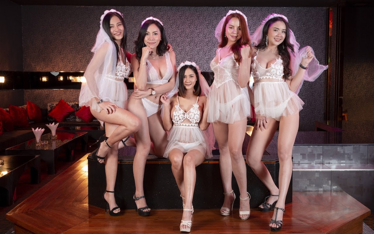 Thai girls dressed as sexy bridesmaid in a KTV room at The PIMP gentlemen club in Bangkok