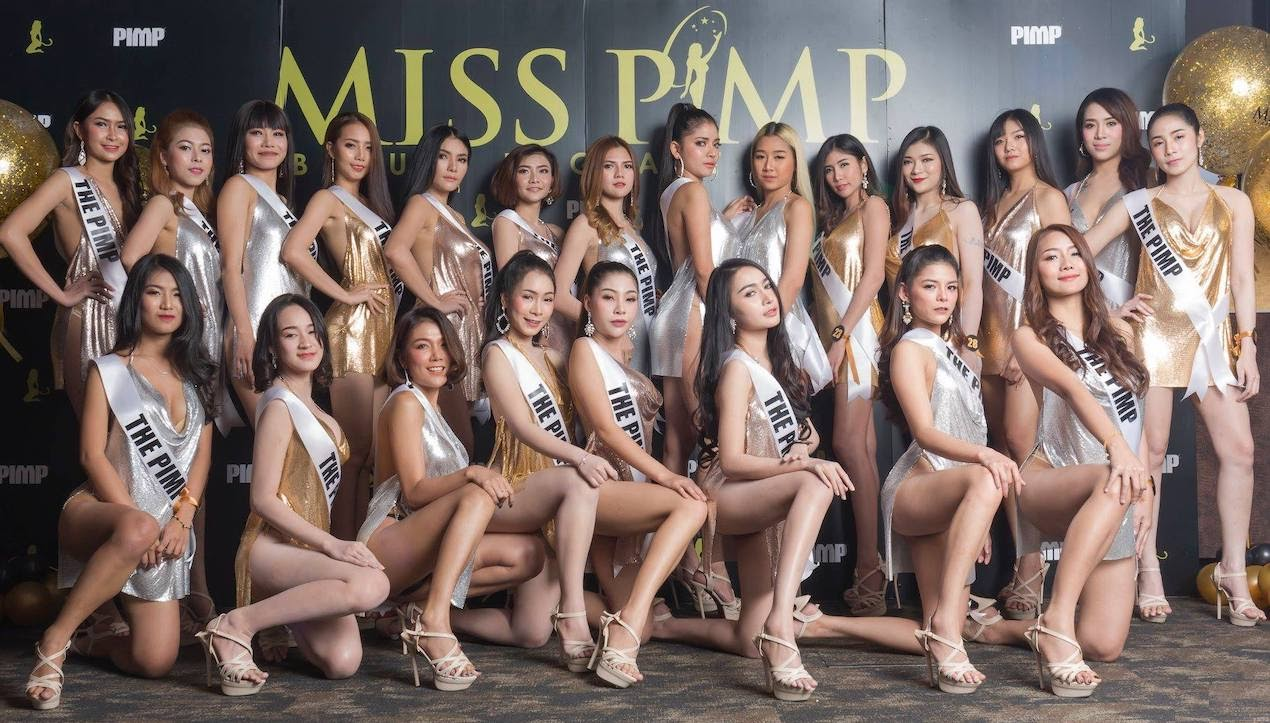 gorgeous Thai girls in gold and silver dresses for the election of Miss PIMP at The PIMP gentlemen club in Bangkok