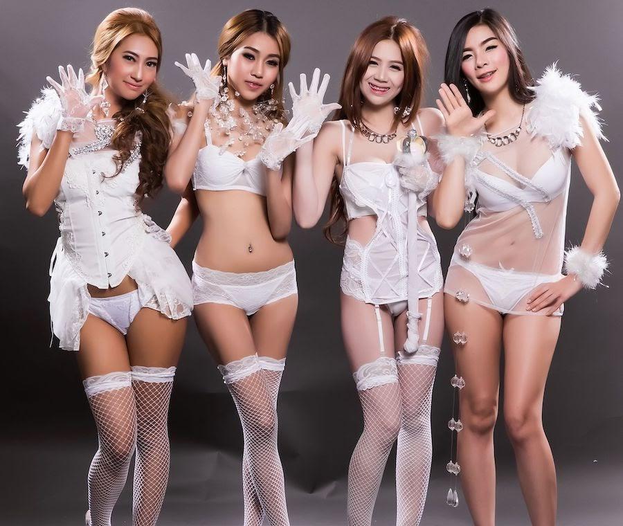 Thai girls dressed as sexy brides in their white lingerie at the best gentlemen club in Thailand