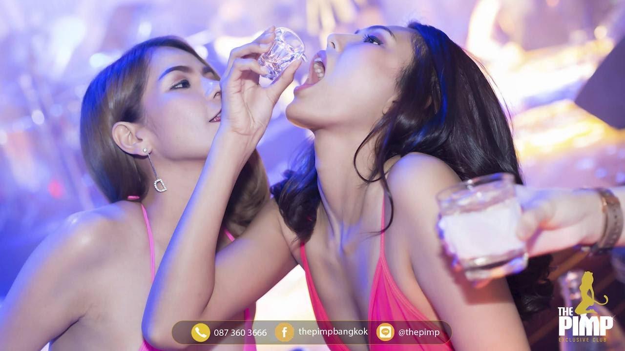 Thai girls drinking shots at a nightclub in Bangkok
