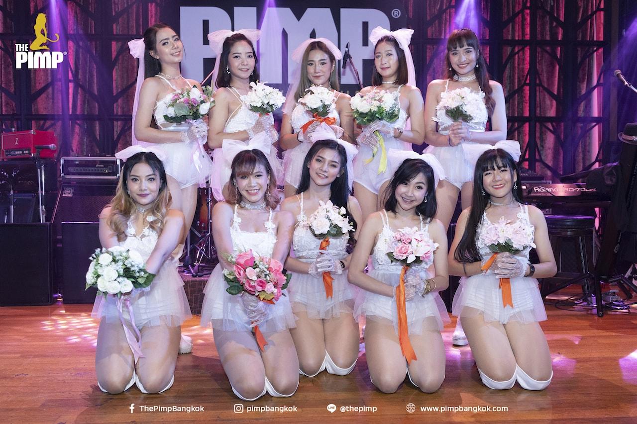 Thai girls dressed as sexy Thai wives in their white dresses at The PIMP KTV nightclub in Bangkok