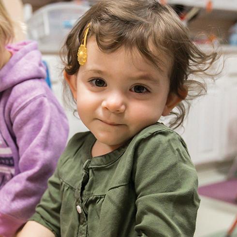 Little girl smiles at Belchertown Day School