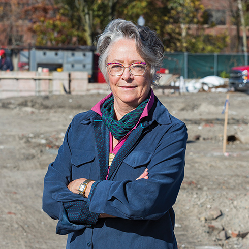 Lucia Searle, Farm Fresh Rhode Island Food Hub Project Manager, stands outside their construction site.