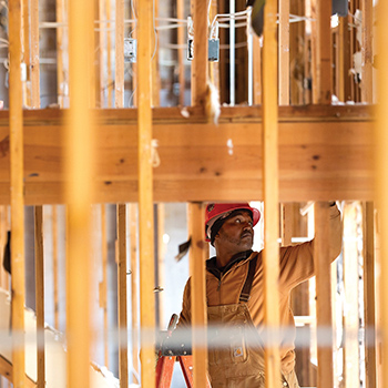 A construction worker on a ladder at The Works CDC site in Memphis.