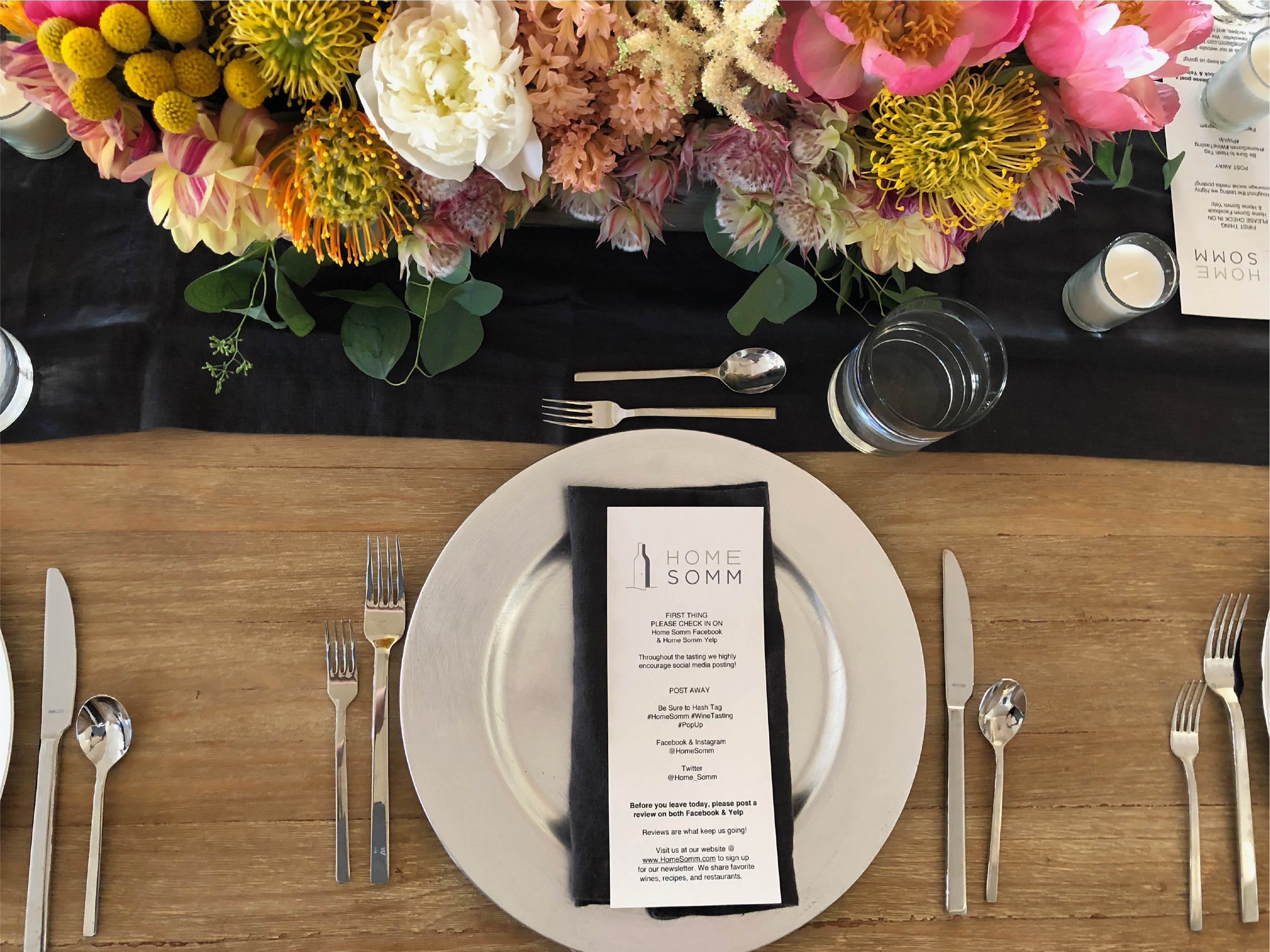 a picture of a plate and beautiful flowers and a menu from Home Somm