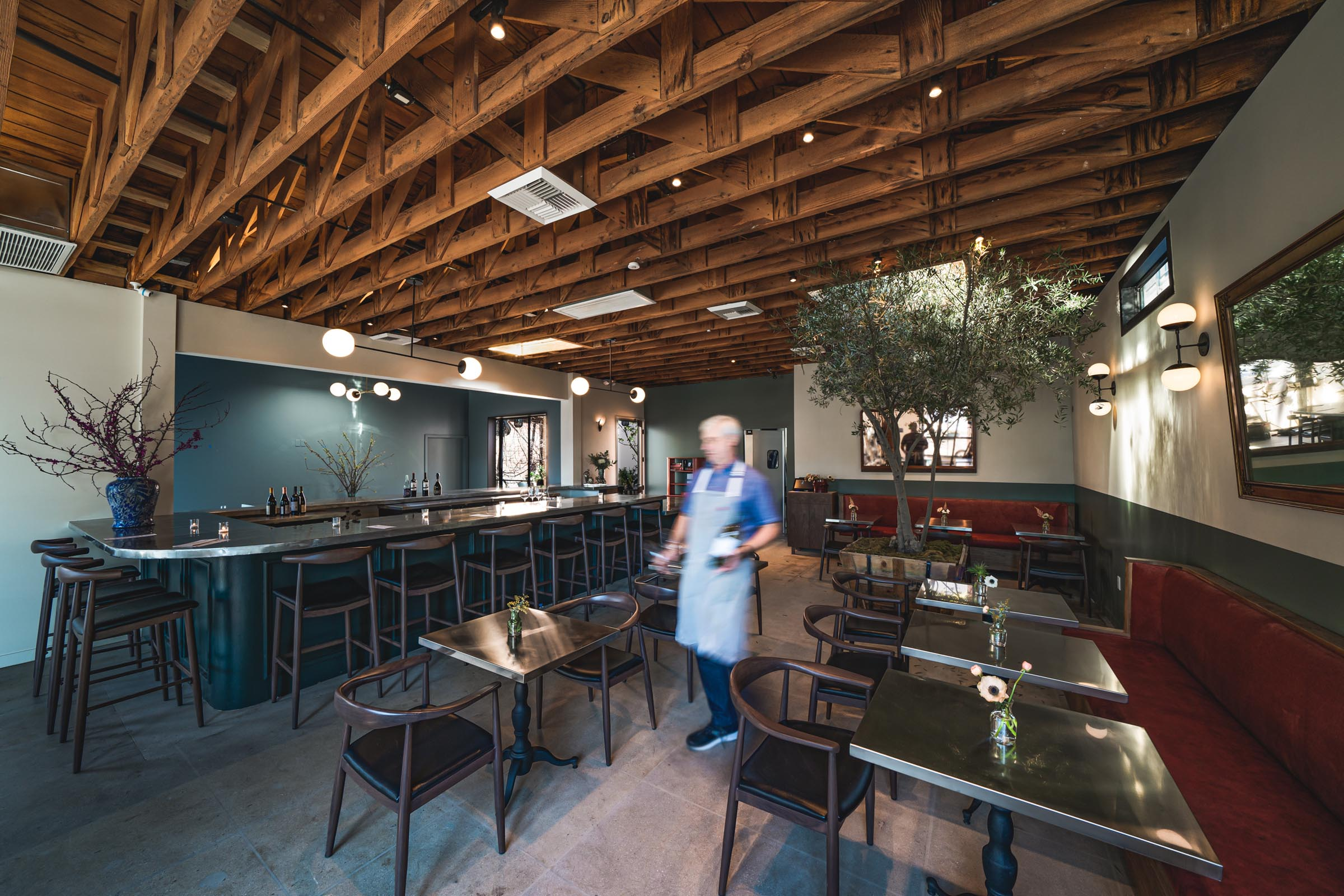 a host moves through the wife and the somm's main dining space
