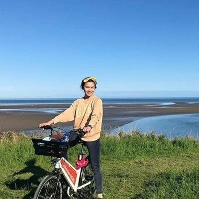 Bleeper user cycling along coast.