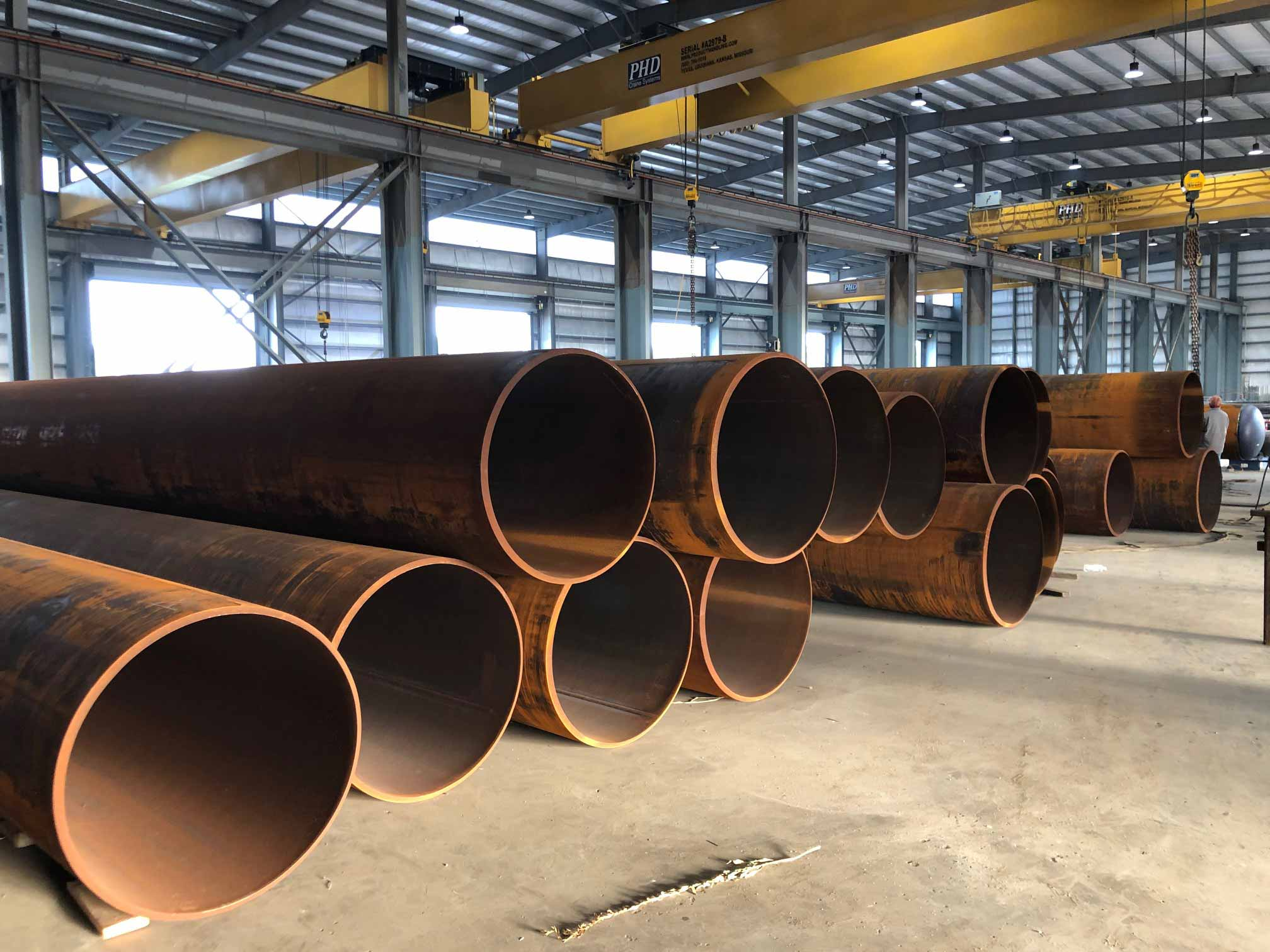 large rolled pipe on shop floor