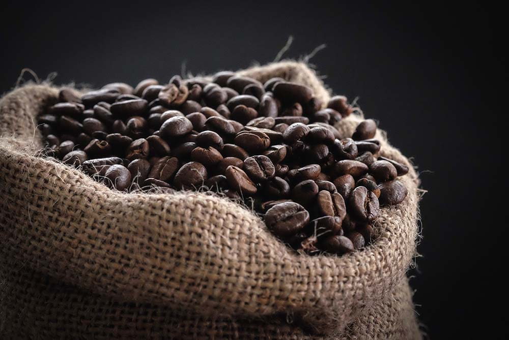 Rough cotton bag with coffee beans