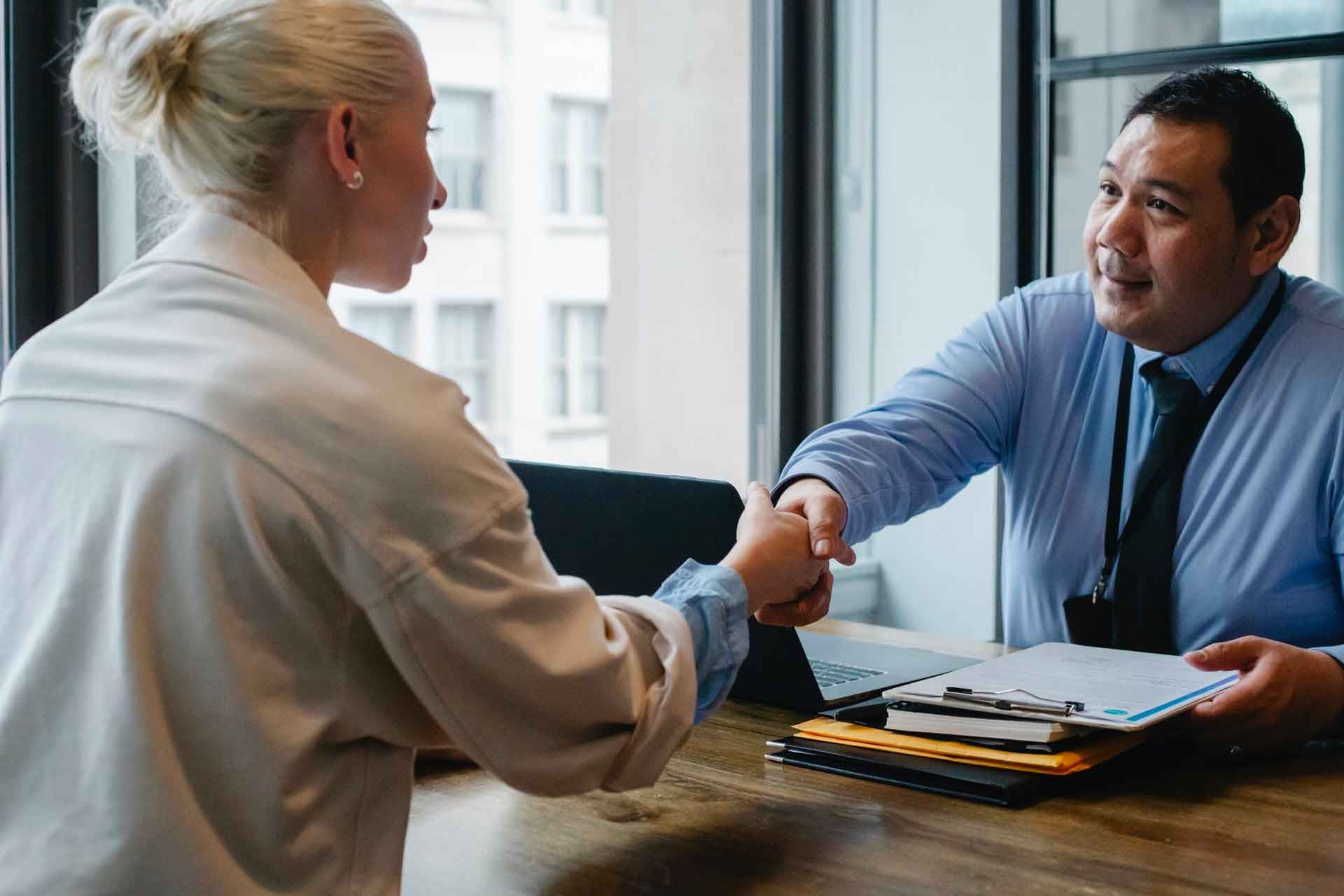 image of recruiter and applicant shaking hands