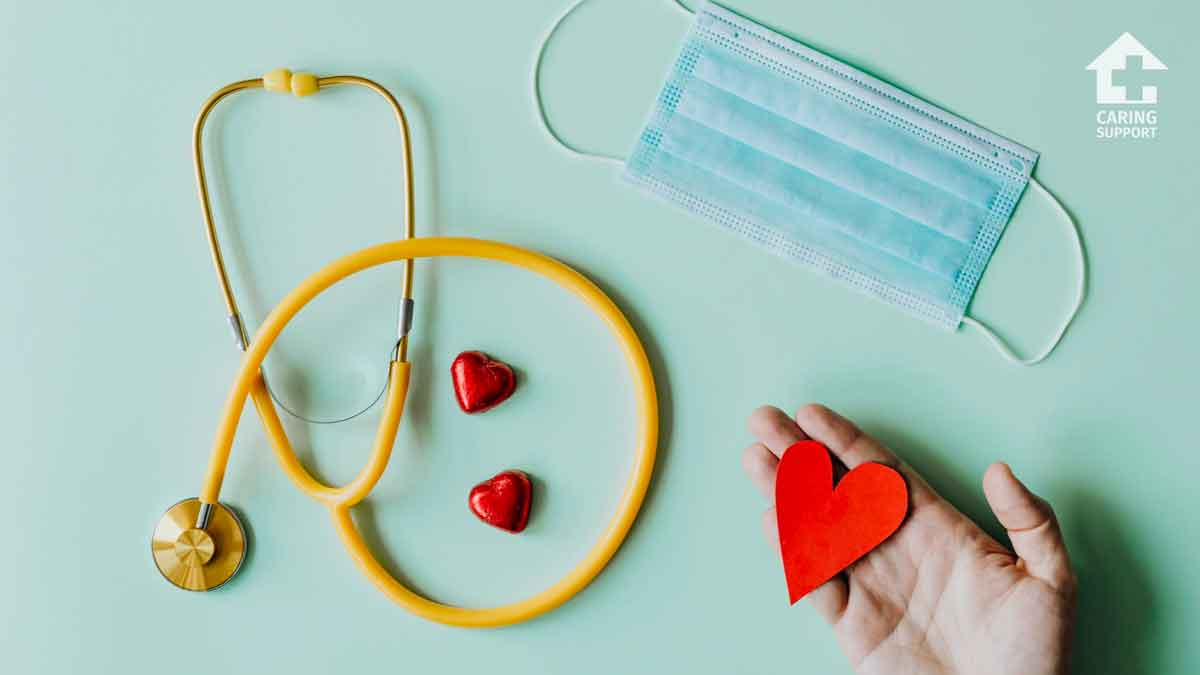 image of stethoscope, mask, and hand with hearts
