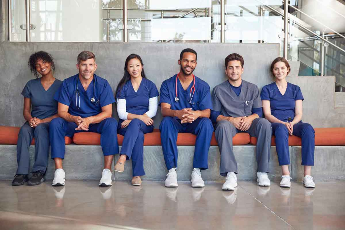 image of healthcare workers sitting on a bench