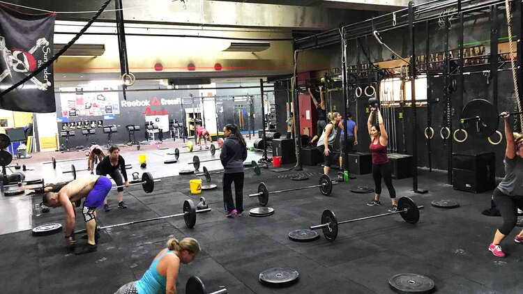 A typical CrossFit gym. Most of these women are probably stronger than me.
