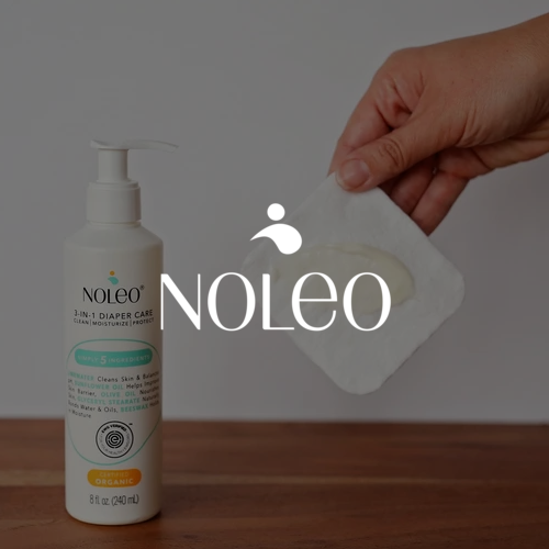 Moisturizing cream from ou baby care company Noleo displayed on a table.