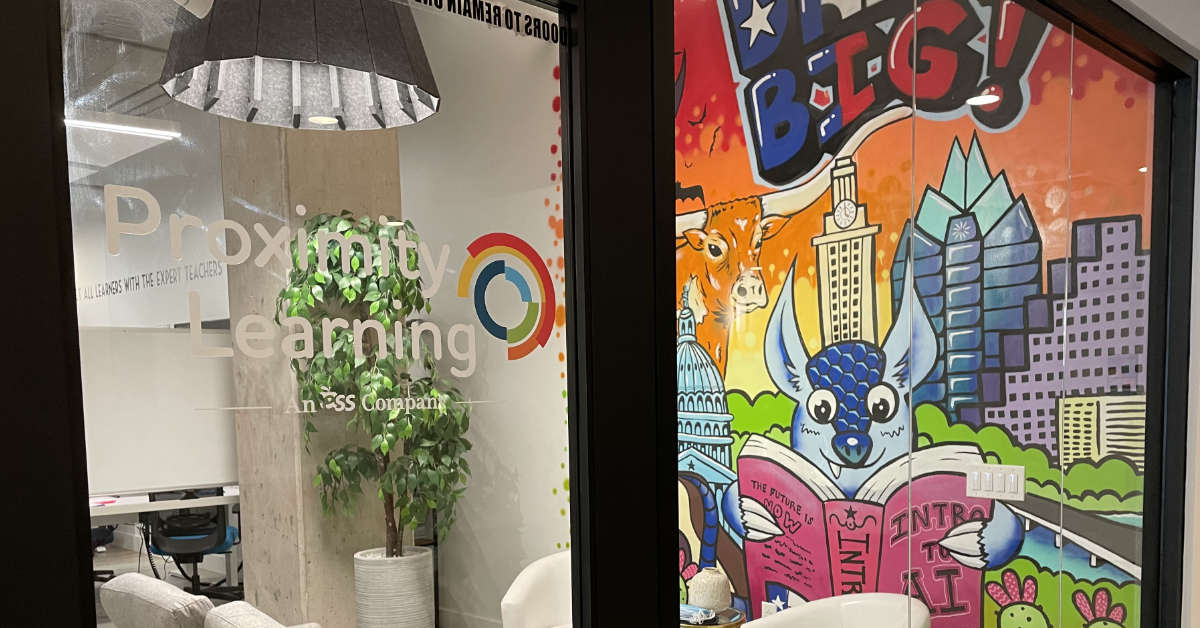 A colorful mural is visible through the front door of Proximity Learning's Austin, Texas office.