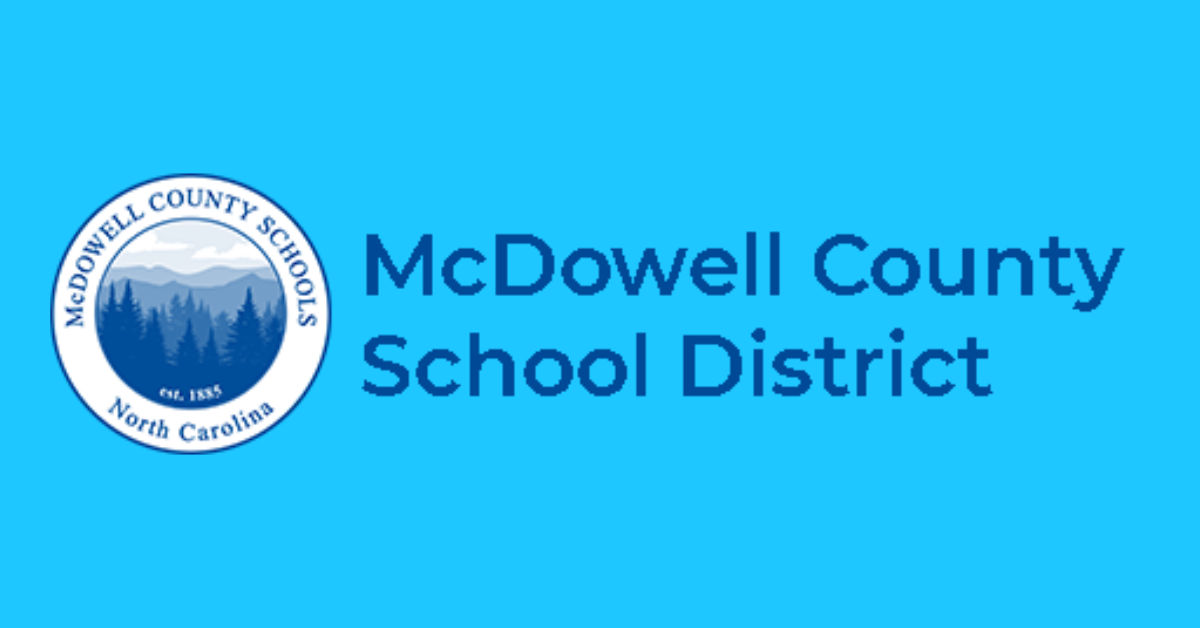 Blue McDowell County School District logo pictures a blue forest and mountains.