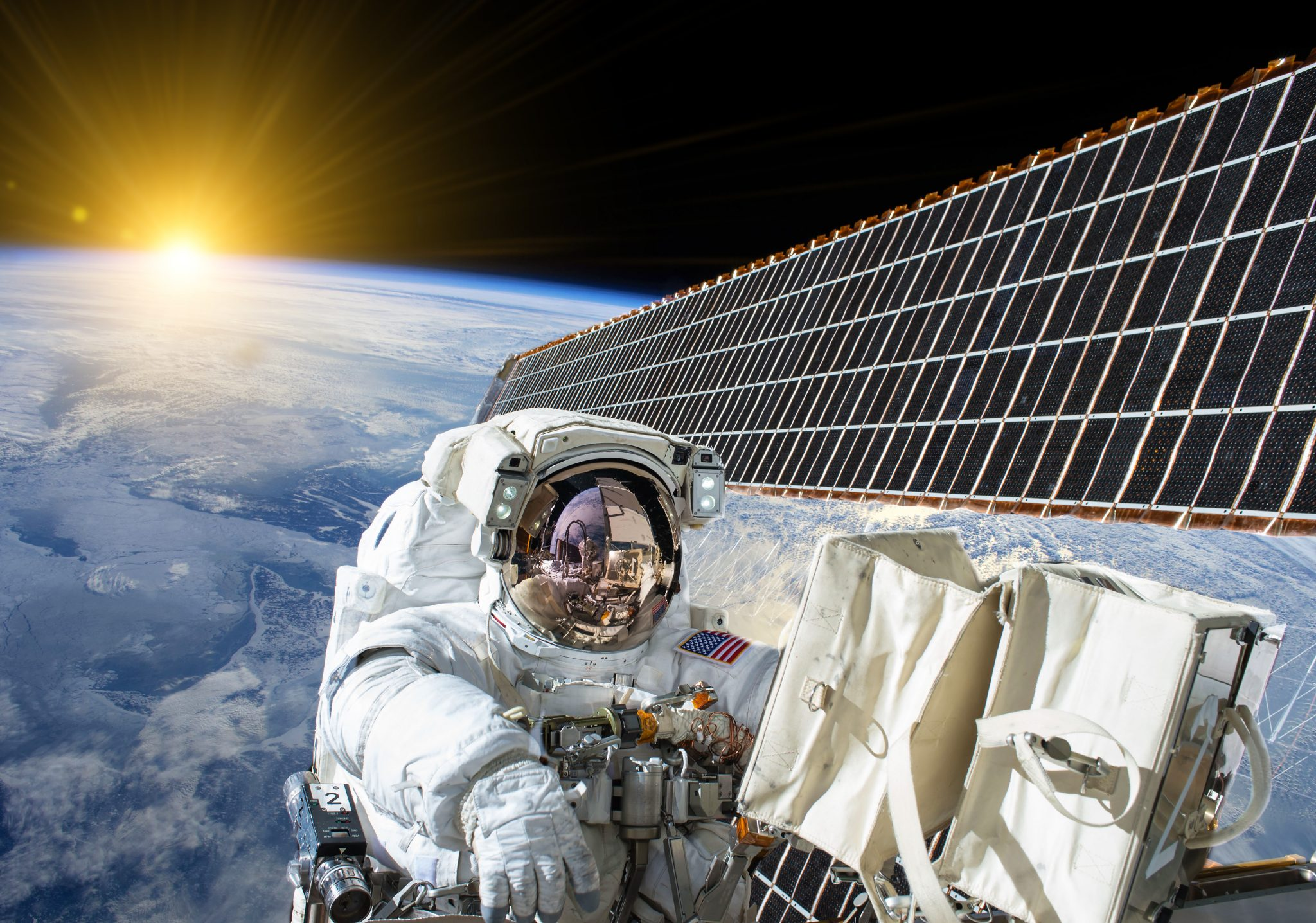 US Astronaut is space next to a satellite