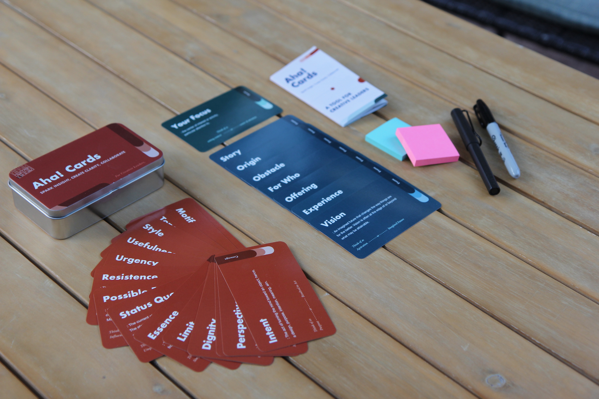 Creative Aha Cards are laid out on the table.  Creative workshop cards and sticky notes.
