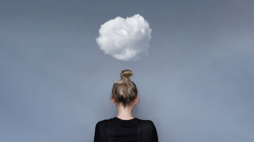 Mental health awareness image - woman with cloud above