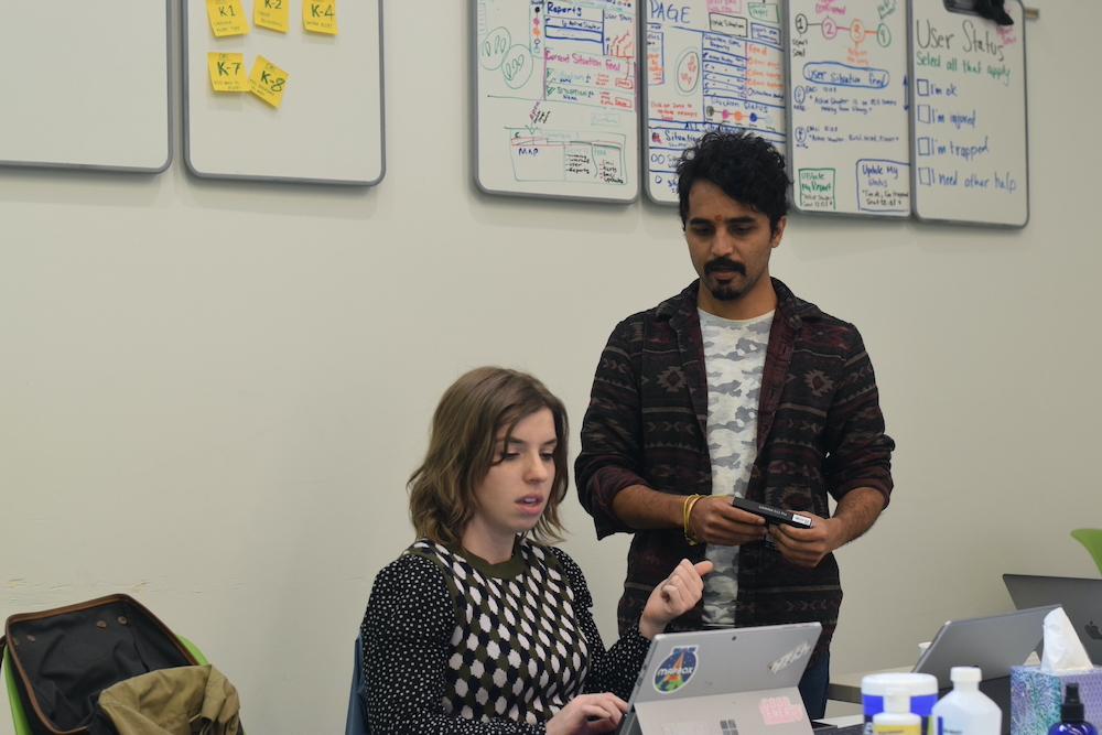 HazAdapt team members discussing work.
