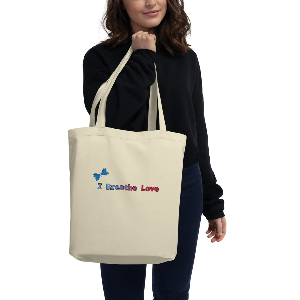 """Say goodbye to plastic, and bag your goodies in this organic cotton I Breathe Love tote bag. There's more than enough room for groceries, books, and anything in between.  Features: • 100% certified organic cotton 3/1 twill • Open main compartment • Dimensions: 16"""" x 14 ½"""" x 5"""" • Weight limit: 30lbs (13.6 kg) • 1"""" wide dual straps, 24 1/2"""" length • Fabric weight: 8 oz/yd² (272 g/m²)"""