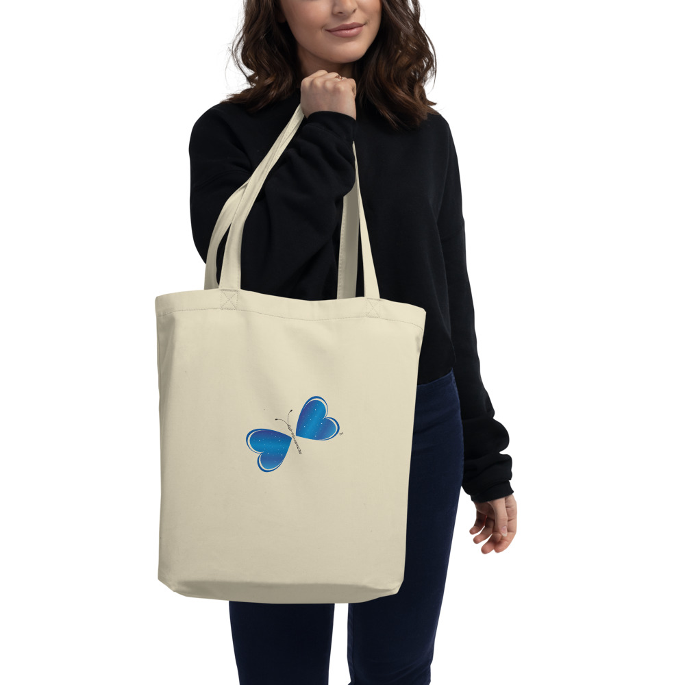 """Say goodbye to plastic and bag your goodies in this organic cotton Be the Change Butterfly tote bag. There's more than enough room for groceries, books, and anything in between.  Features: • 100% certified organic cotton 3/1 twill • Open main compartment • Weight limit: 30lbs (13.6 kg) • 1"""" wide dual straps, 24 1/2"""" length • Fabric weight: 8 oz/yd² (272 g/m²) • Dimensions: 16"""" x 14 ½"""" x 5"""""""