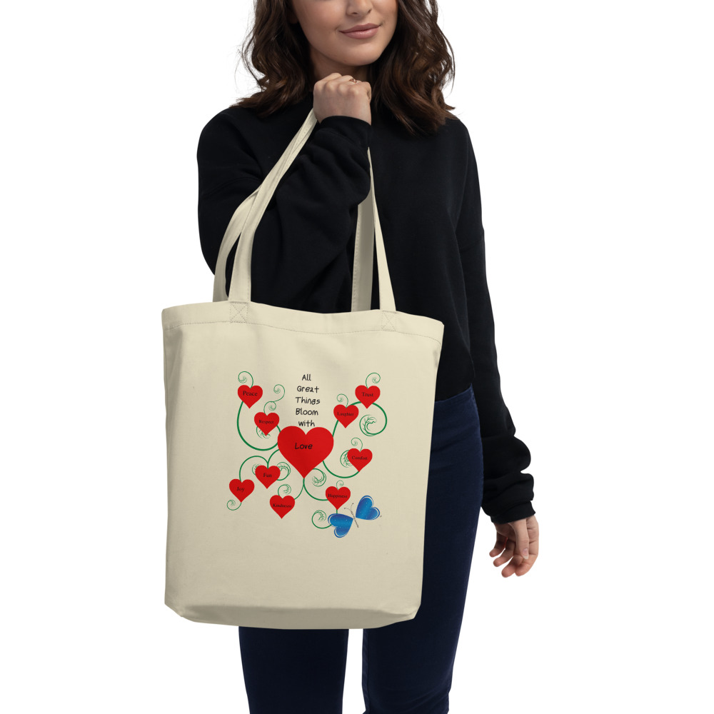 """Spread the message of Love and bag your goodies in this organic cotton Bloomin' with Love tote bag. Large enough for groceries, strong enough for books, and anything in between.  Features: • 100% certified organic cotton 3/1 twill • Open main compartment • 1"""" wide dual straps, 24 1/2"""" length • Weight limit: 30lbs (13.6 kg) • Fabric weight: 8 oz/yd² (272 g/m²) • Dimensions: 16"""" x 14 ½"""" x 5"""""""