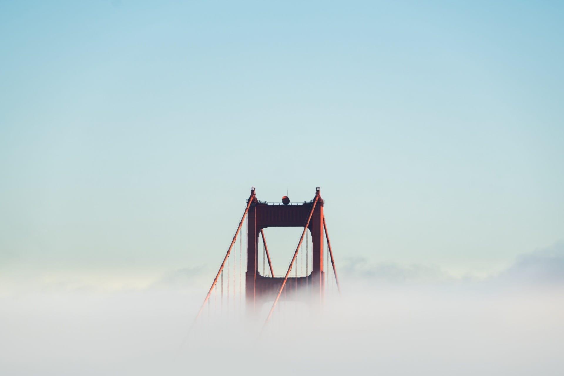 Golden gate bridge through the clouds