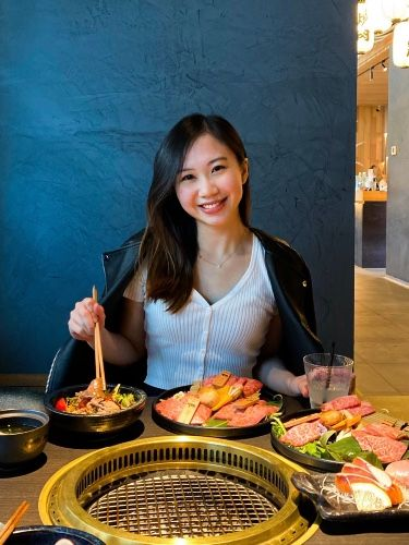 A girl sitting in a Korean all you can eat restaurant