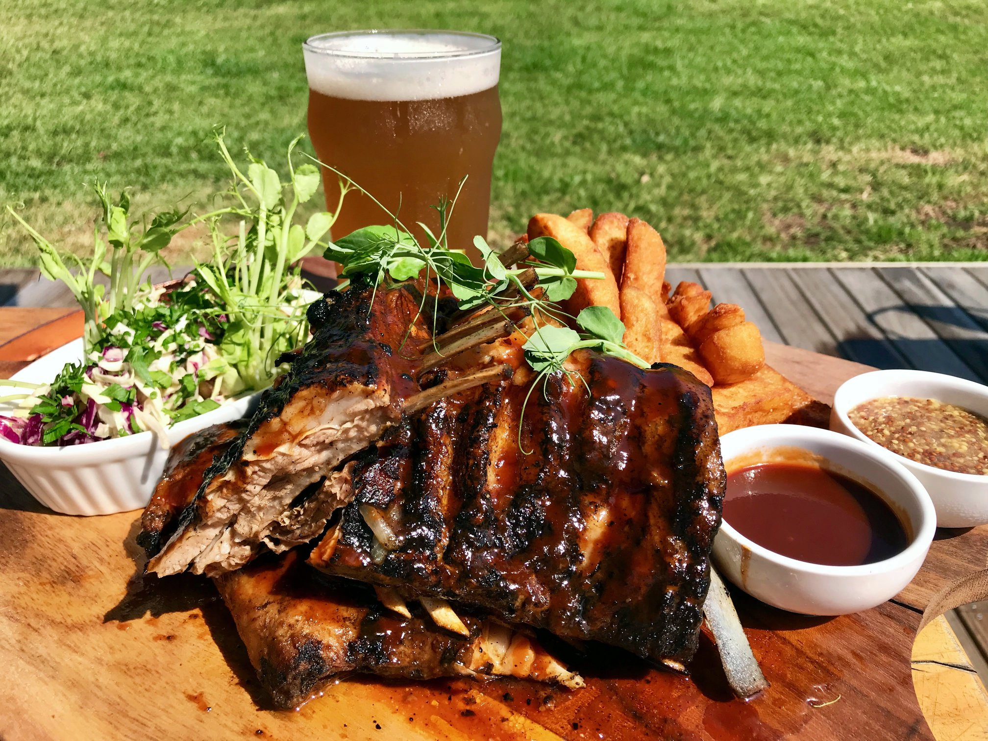 Travis Road Trips from Sydney Guide - Ribs and beer served by Murray's Brewing