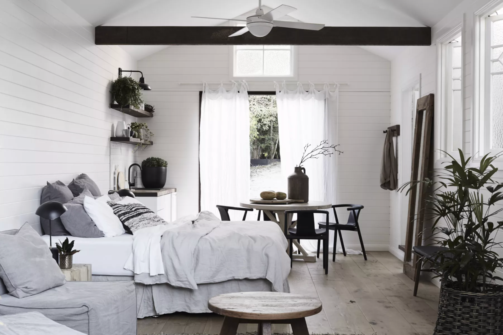 Bedroom of The Bower with a queen bed and black and white furnishings